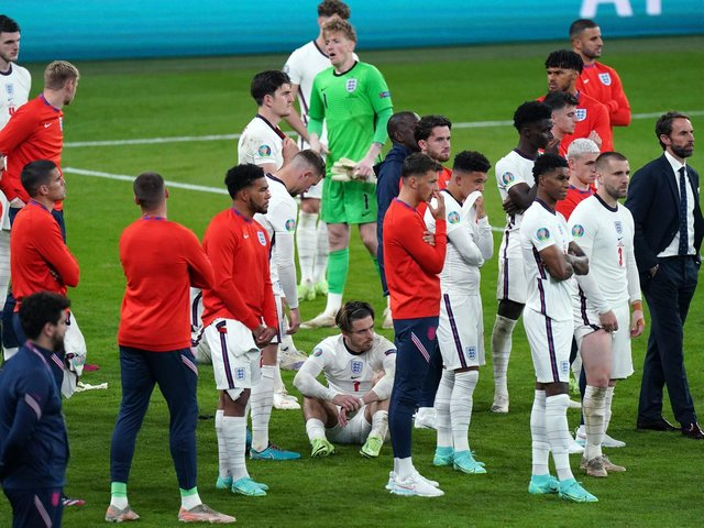 A dejected England side after the penalty shootout at Wembley