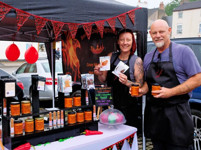 Pete and Emma Yates from Bertie Chippington's Hot Sauce on their stall at the market