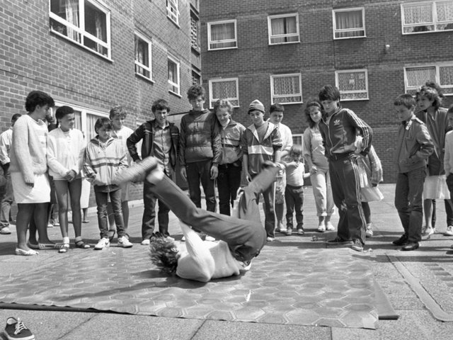 An afternoon of fun and music could mark the turning point for the residents of a strife-torn flats complex. Their summer festival may not have been as lavish or big as many Lancashire carnivals but in many ways it was more important. For the people who live in three high-rise blocks on Moor Lane, Preston, it was an important step towards creating community spirit in a place where it has been sadly lacking. Pictured: A group of lads calling themselves 'Level One' gave demonstrations of breakdancing