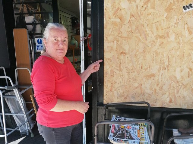 Belinda Armstrong with the boarded-up window at the Ist Scouts shop in Fleetwood