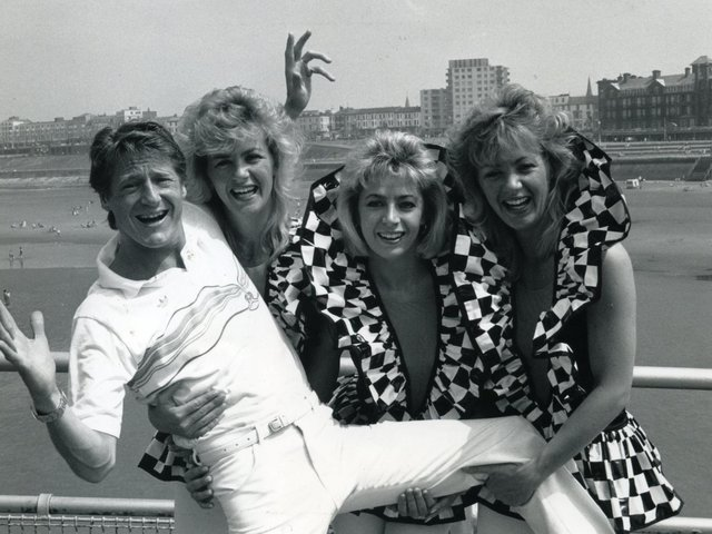 Entertainer Joe Longthorne gets ready for summer season with the Ray Cornell dancers on North Pier, Blackpool in 1987