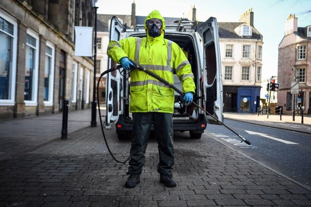 Robin Barclay, cleaning contractor, poses on a street in Glasgow (Photo: ANDY BUCHANAN/AFP via Getty Images)