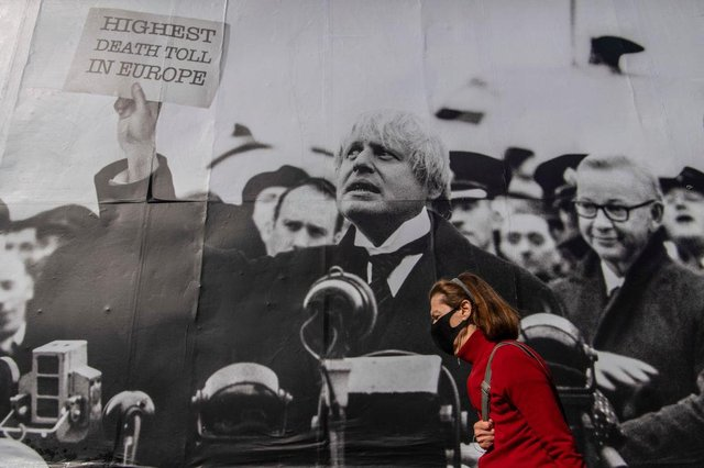 """A satirical poster from the group Led By Donkeys depicting Boris Johnson as former British prime minister Neville Chamberlain delivering his """"Peace for Our Time"""" speech in Kentish Town, London (Photo: Justin Setterfield/Getty Images)"""